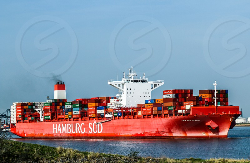 Container ship getting ready to anchor on Antwerpen port Belgium photo
