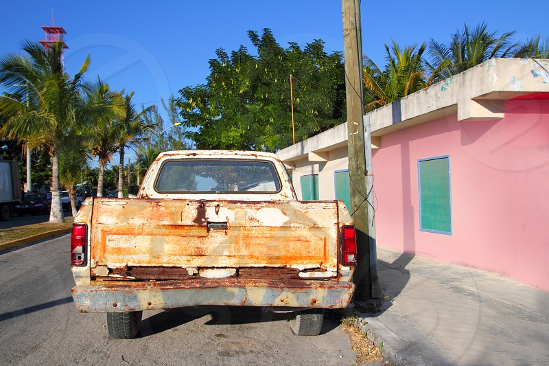 aged vintage weathered truck in tropcial mexico photo