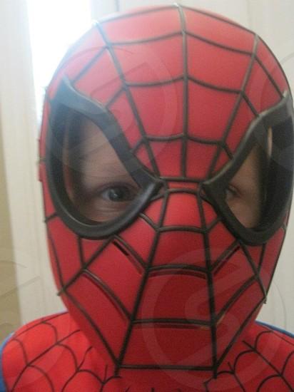 child wearing spiderman mask photo