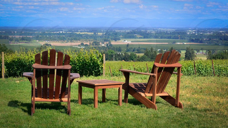 two brown wooden adirondock chairs photo