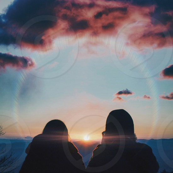 two people silhouette during sunrise photography photo