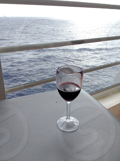 A glass of wine on a cruise ship in the Bahamas photo