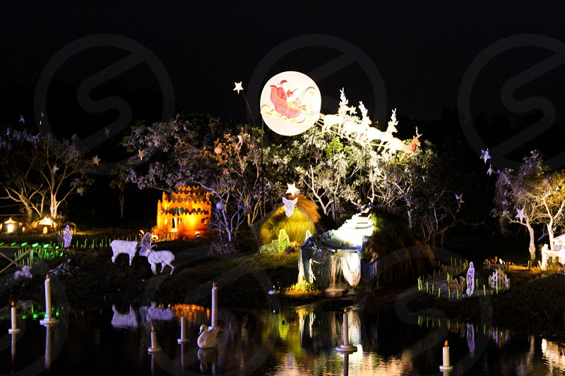 Christmas nativity scene crib over a lake in India Goa Christmas Santa reindeer stars photo