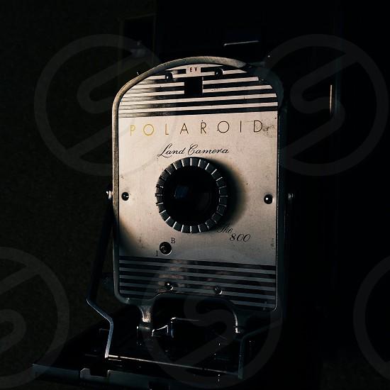 black polaroid round button photo