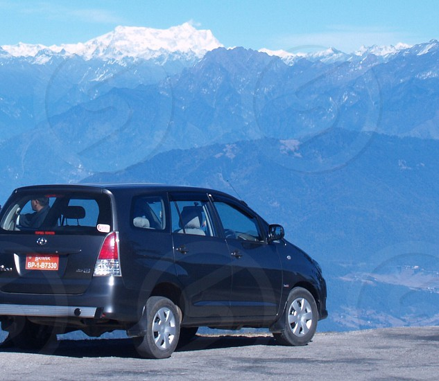 Bhutan plate number Himalaya mountain snow transportation vehicle scenic landscape view height car exploring  photo
