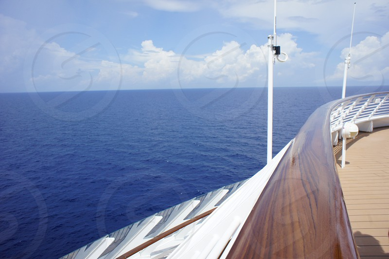 Cruise ship railing and ocean view photo