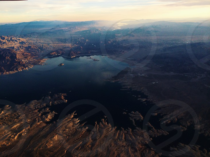 aerial photography of mountain and lake photo