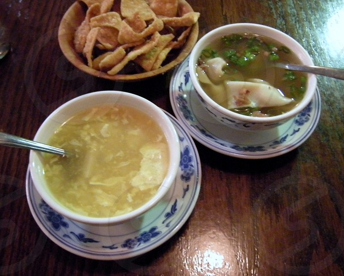 Egg drop and wonton soups with fried noodles Chinese food photo