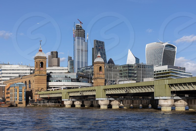 LONDON UK - MARCH 11 : View along the River Thames towards the City of London on March 11 2019 photo