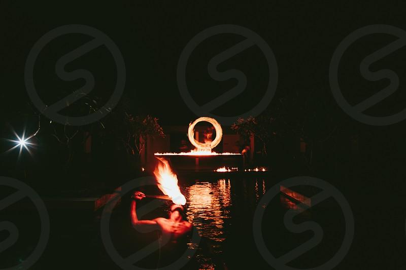 Fire firedance dance entertainment danger tongue eating fire fire dancer light torch warrior fiji pacific smoke dark night wedding  photo