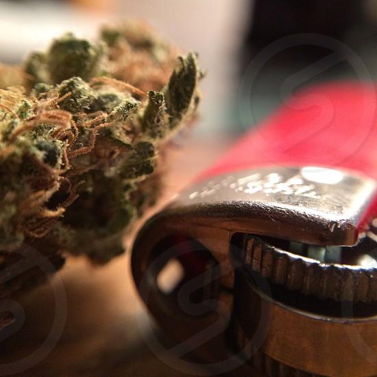 Lighter and nug of marijuana  photo