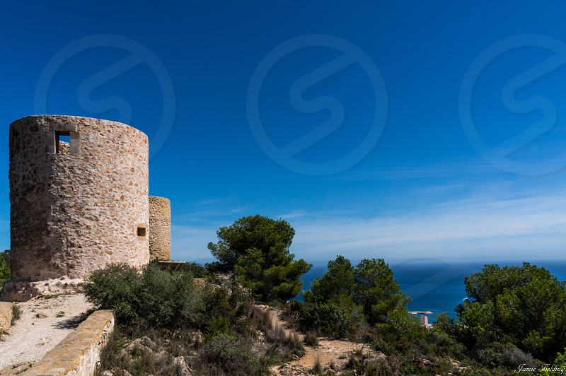 Windmill Costa blanca javea blue blue sky view ocean sea Spain photo
