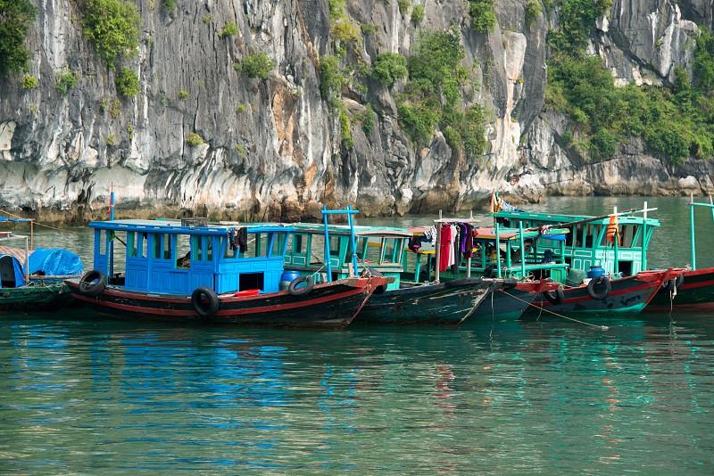 Fishing junk boats lined up in Ha Long Bay North Vietnam. photo