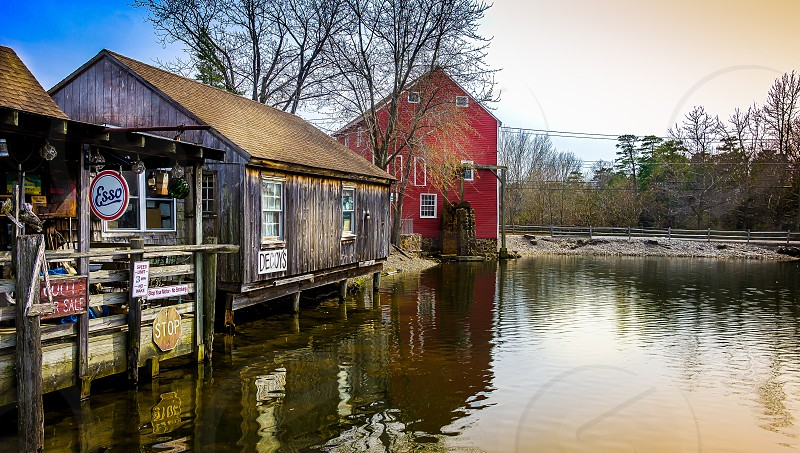 brown wooden house beside lake  photo