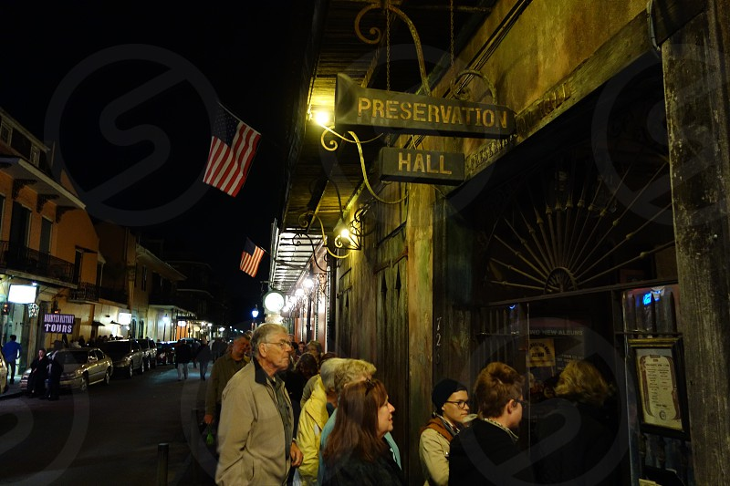 People lining up to the famous Preservation Hall jazz club.  photo