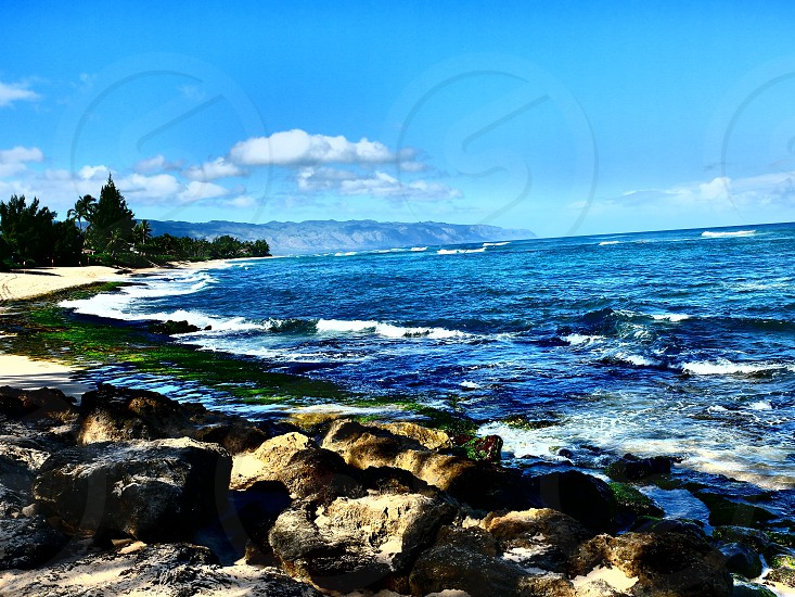 Hawaii north shore beach rocks blue green Sky waves  photo