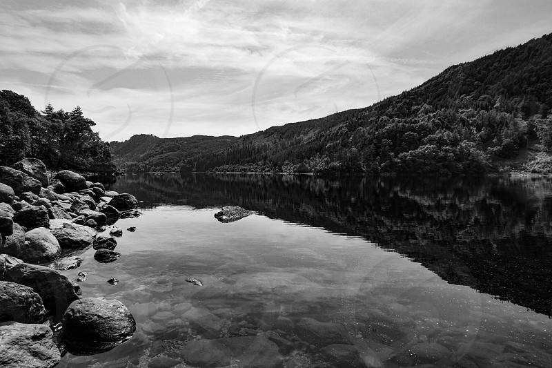 Black and white lake reflection of mountain forest photo