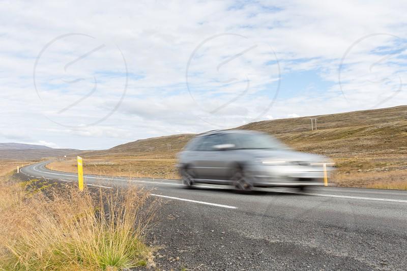 A car speeding through the countryside photo
