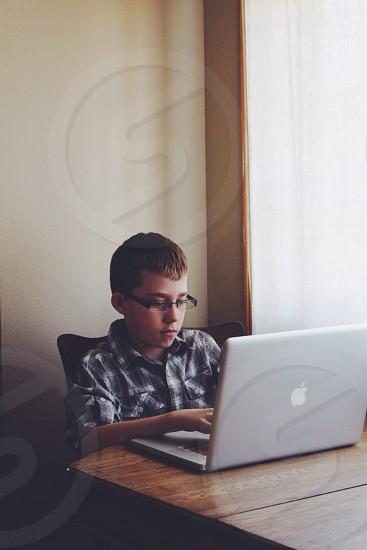 boy using macbook photo