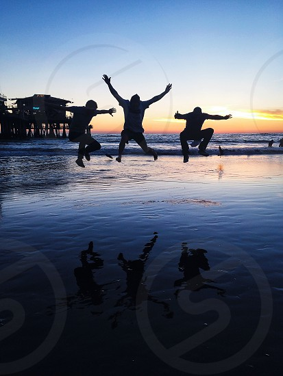 3 men jumping photo