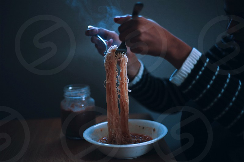 rice noodles on white ceramic bowl photo