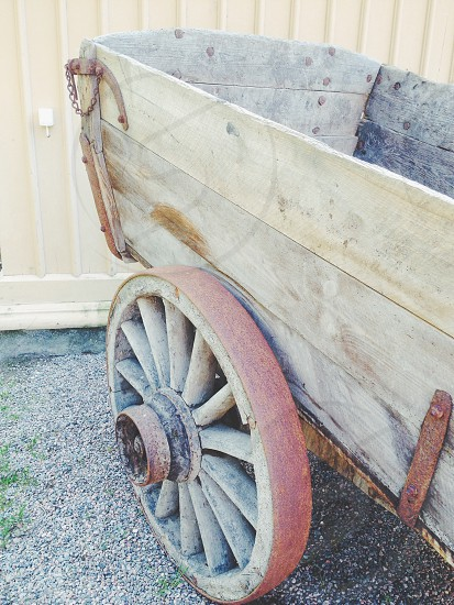 brown wooden cart on pebbles photo