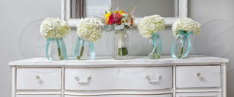 wedding flowers on a vintage dresser photo