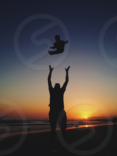 a man and a baby silhouette photo