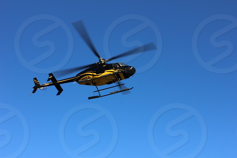 black and yellow helicopter on sky photo