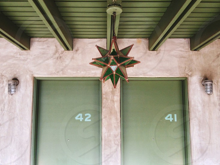 view of green wooden door with number 42 on left and 41 on right photo