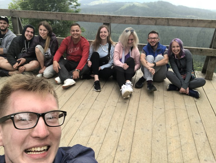 Awesome groupie of friends from mountain hiking photo