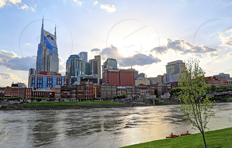 Nashville Tennessee USA - April 27 2018: Downtown Nashville Tennessee The Music City seen at dusk from The Cumberland River. photo