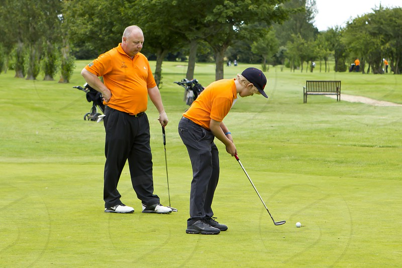Dad and Son Golfing photo