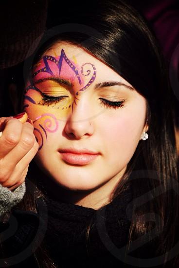 Purple flower face painting photo