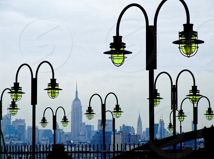 New York City Skyline framed by lamps on Liberty Island photo