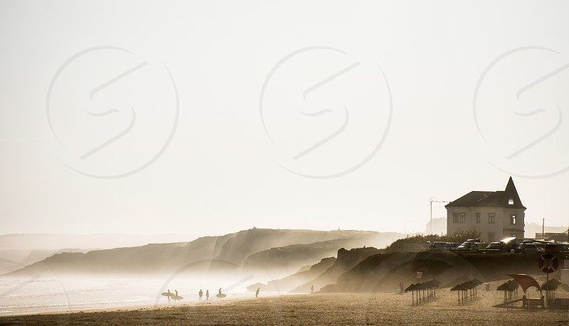morning surfers by peniche beach photo