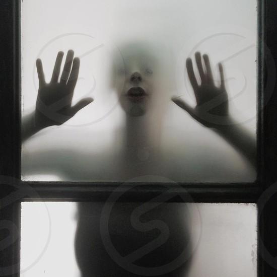 person holding window pane photo
