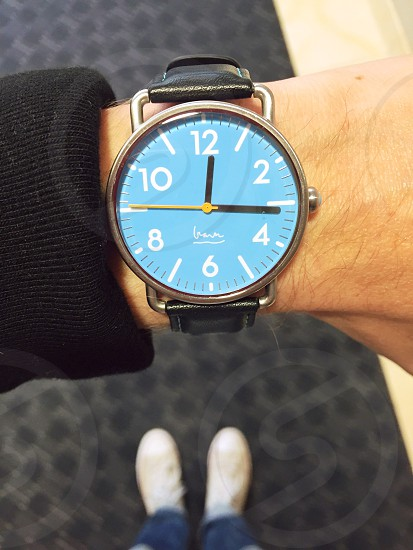 blue face wristwatch reading 12:16 photo