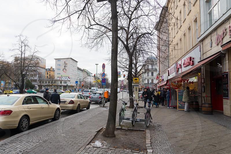 Famous street food Kebap and curry wurst on Mehringdamm street inside Kreuzberg Neighborhood in Berlin Germany photo
