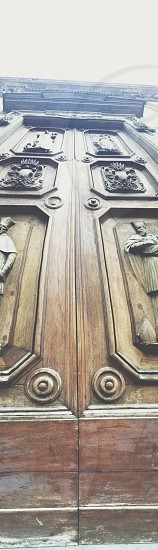 low-angle photography of brown wooden door photo