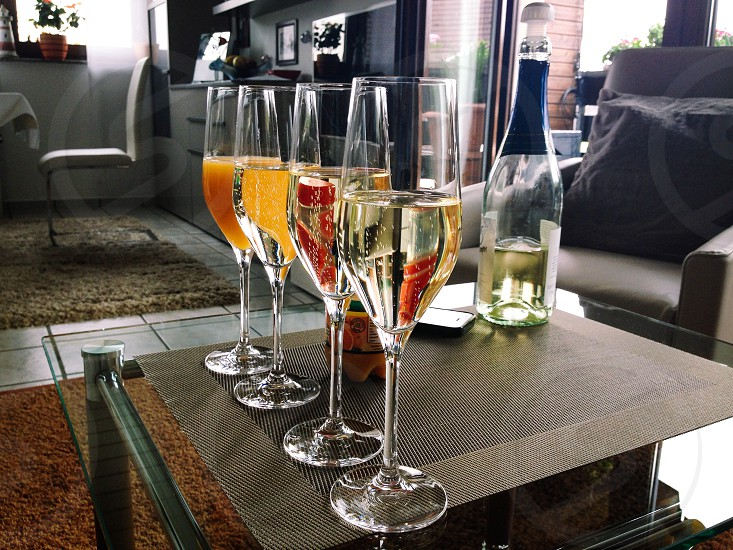 Welcome drink warmth welcome Three glasses Sparkling wine and a juice photo