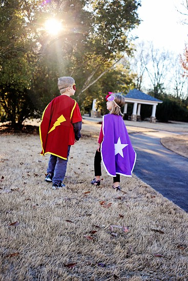 kids on purple and red cape photo
