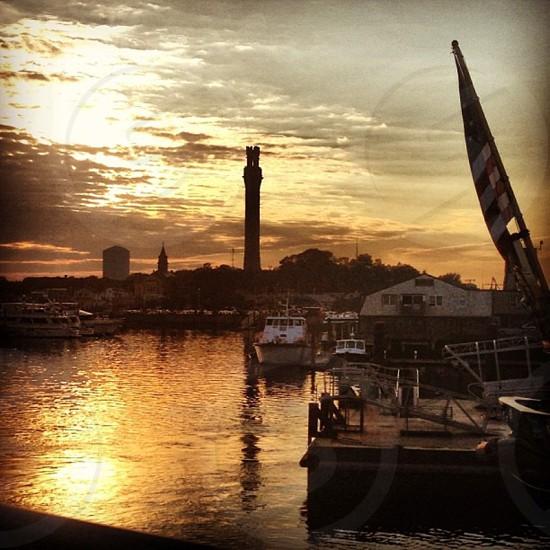 Summer sunset over Provincetown Massachusetts. Pilgrim Monument. American Flag. Harbor. photo