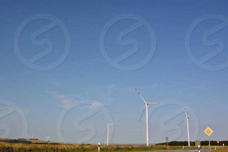 windmills on green field photo