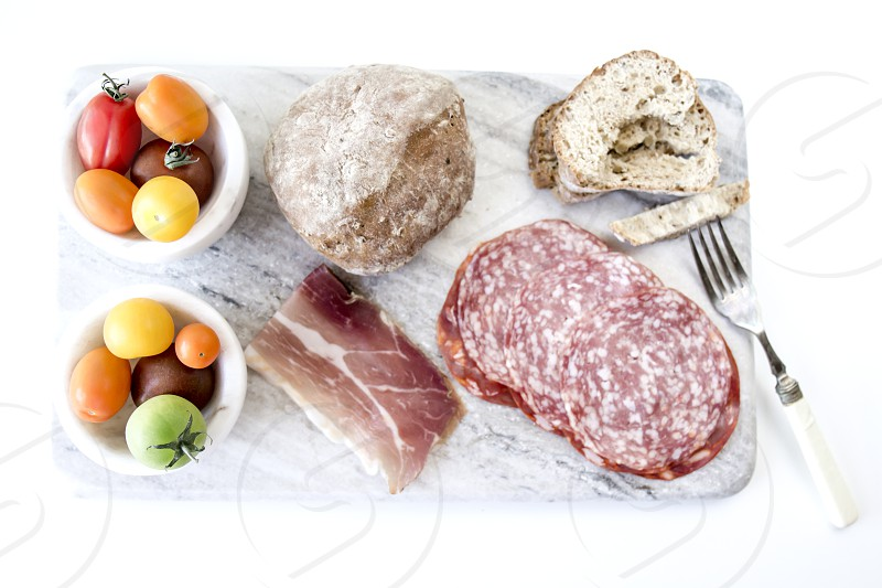 salami; bread; italian; selection; platter; food; snack; tomato; salad; bowls; marble  photo