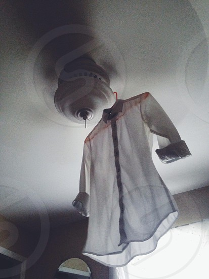 white button up shirt on hanger photo