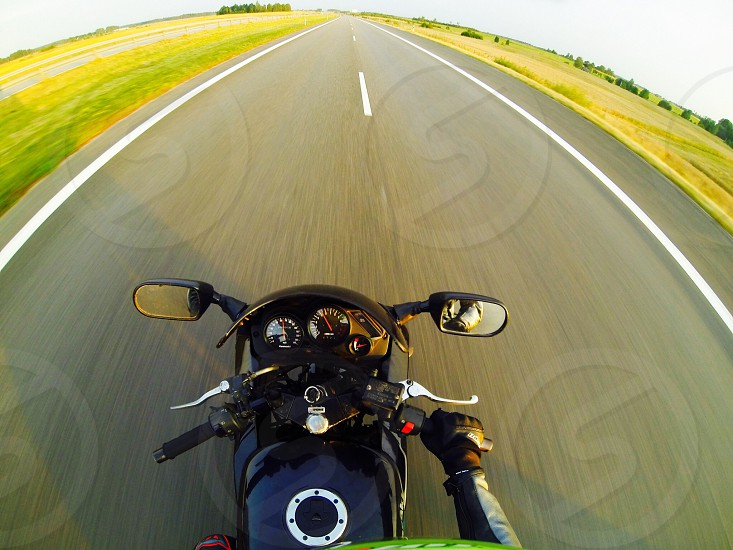 Riding motorcycle passion world road highway photo