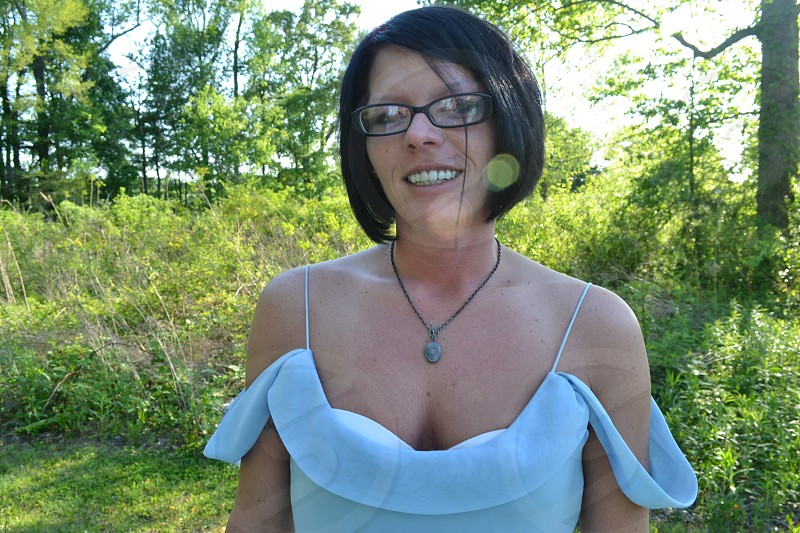 woman gray cowl top and black framed eyeglasses photo