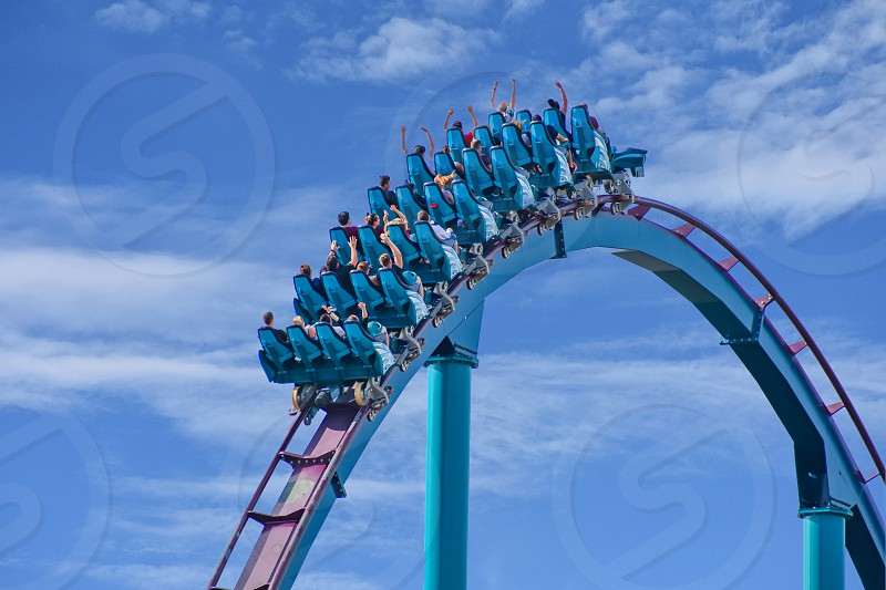 Orlando Florida . February 17  2019  People enjoying Mako Rollercoaster on lightblue cloudy sky background in International Drive area (6) photo