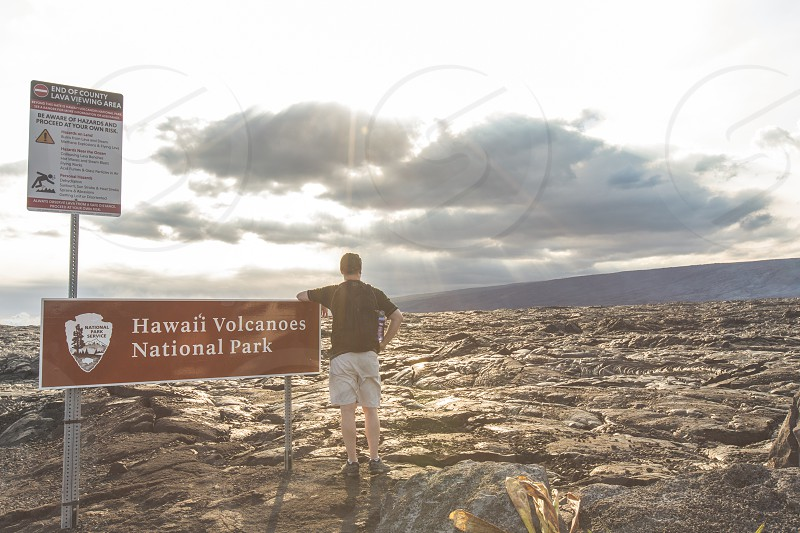 A man looking over the lava fields at Hawaii Volcanoes National Park on the Big Island photo